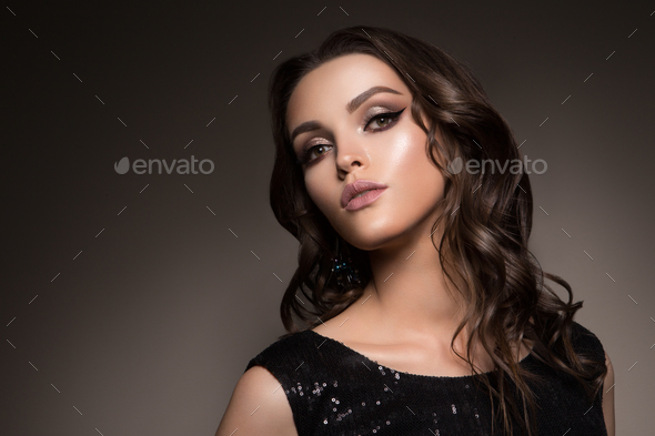 Beautiful young brunette with make-up - Stock Photo - Images