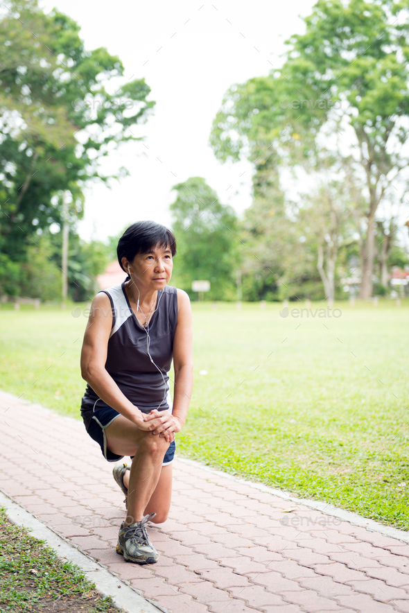 Senior woman exercising in park - Stock Photo - Images