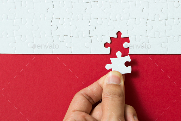 Red background made from jigsaw puzzle - Stock Photo - Images