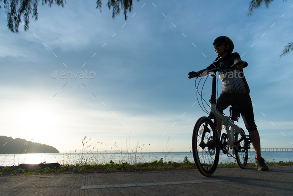 Silhouette cyclist at sunset - Stock Photo - Images
