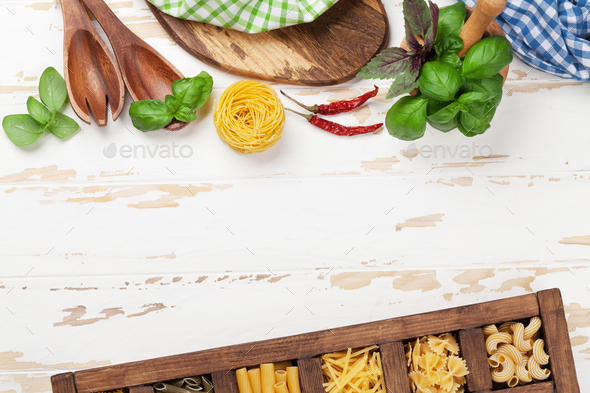 Cooking table with utensils and ingredients - Stock Photo - Images