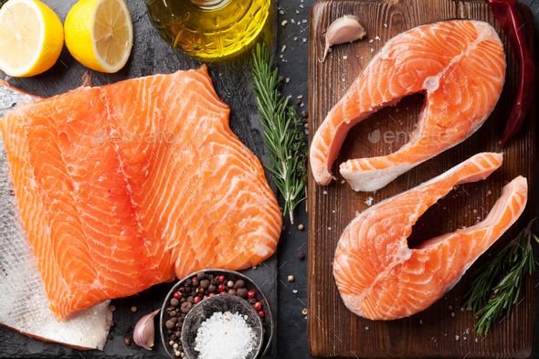 Raw salmon fish steaks and fillet - Stock Photo - Images