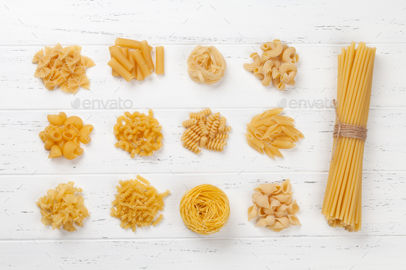Various pasta on white wooden table - Stock Photo - Images