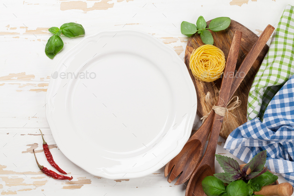 Empty plate with utensils and herbs - Stock Photo - Images