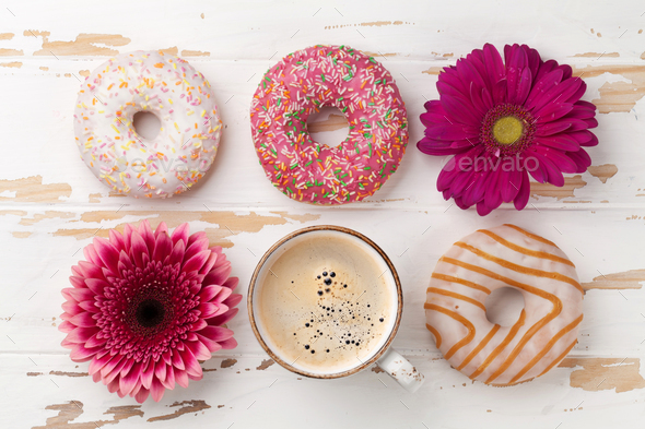 Coffee, donuts and flowers - Stock Photo - Images