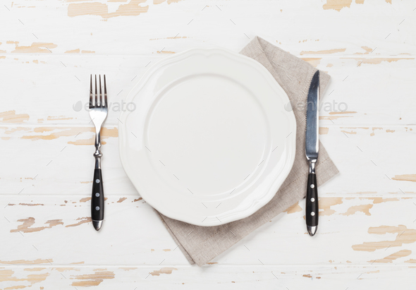Empty plate with silverware - Stock Photo - Images