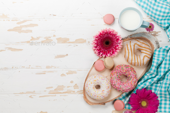Milk, donuts and flowers - Stock Photo - Images