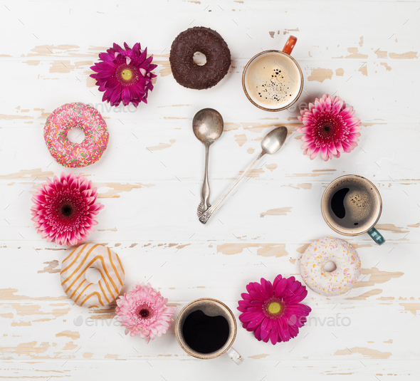 Coffee cup, donuts and gerbera flowers clock - Stock Photo - Images