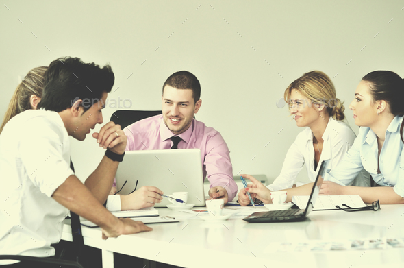 Group of young business people at meeting - Stock Photo - Images