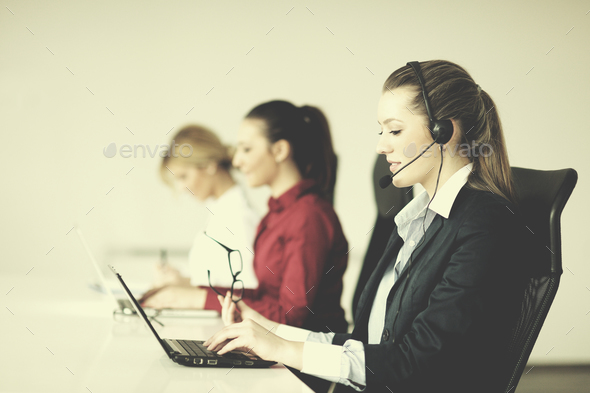 business woman group with headphones - Stock Photo - Images