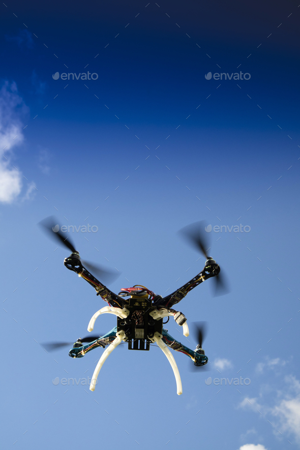 Drone in flight with cloudy sky - Stock Photo - Images