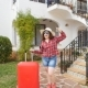 Happy Young Woman with Red Suitcase Arriving To the Resort or Apartment - VideoHive Item for Sale