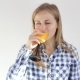 Healthy Young Girl Drinks Orange Juice - VideoHive Item for Sale