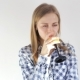 Girl Drinks Fresh Orange Juice and Looks Into the Camera - VideoHive Item for Sale