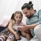 Father with Cheerful Little Daugher Playing with Smartphone and Talking - VideoHive Item for Sale