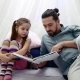Little Girl and Her Father Reading a Book Together - VideoHive Item for Sale