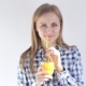 Beautiful Girl Drinks Freshly Squeezed Orange Juice Through a Straw - VideoHive Item for Sale