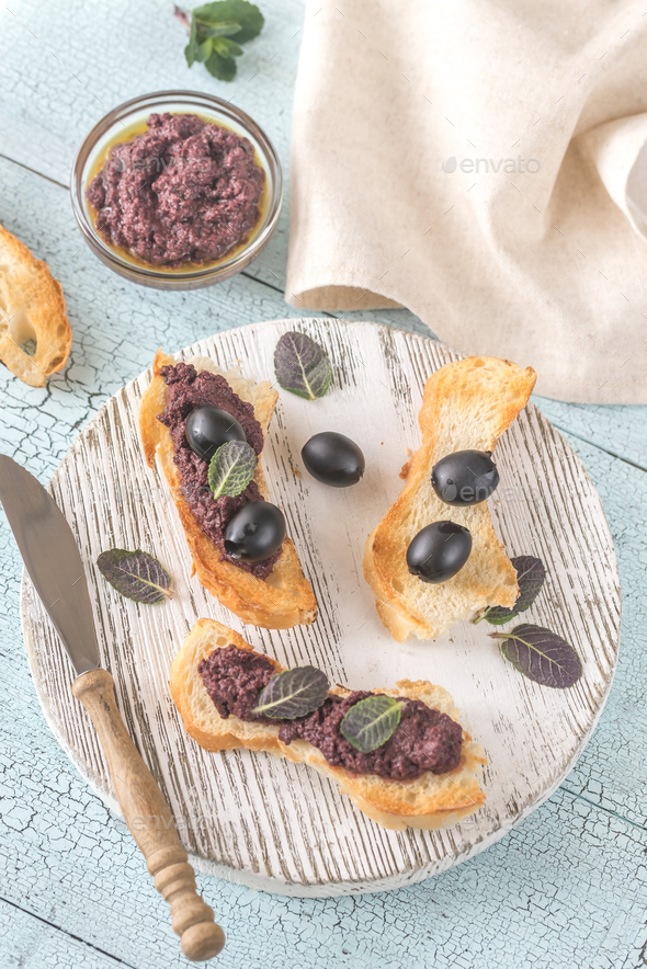 Toasts with black olive pate  - Stock Photo - Images