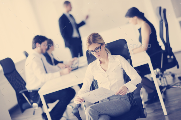 business woman with her staff in background - Stock Photo - Images
