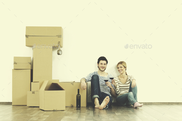 Young couple moving in new home - Stock Photo - Images
