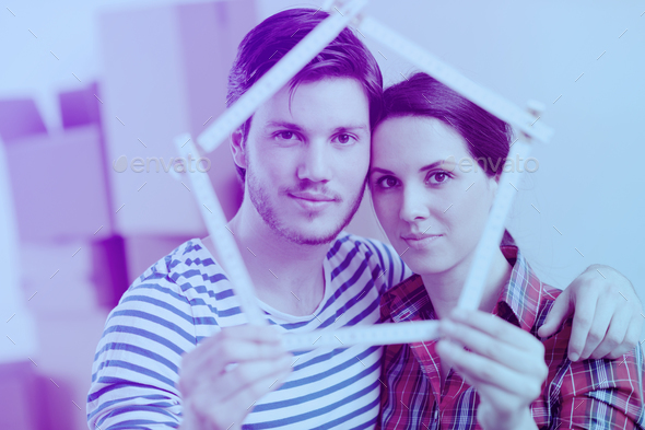 Young couple moving in new house - Stock Photo - Images