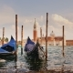 Two Gondolas at the Pier Against the Backdrop of the Coastline of Venice, Italy. In the Foreground - VideoHive Item for Sale