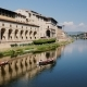 Two Boats Sail Along the Arno River, Beautifully Reflected in the Water. With a View of Florence and - VideoHive Item for Sale