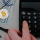 Silver Bitcoin with Many Dollars on the Working Table and Calculator - VideoHive Item for Sale