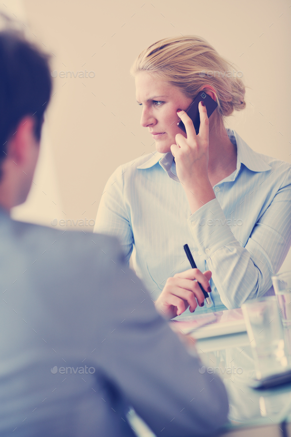 young business woman talk by cellphone on meetng - Stock Photo - Images