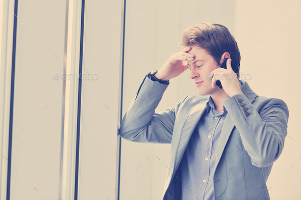 young business man talk by cellphone - Stock Photo - Images
