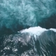 Surfers Catch and Ride the Wave on Reef Turquoise Ocean and the Waves Crashing on the Rocks - VideoHive Item for Sale