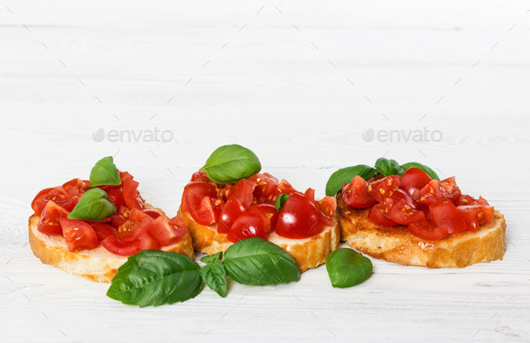 Bruschetta with fresh tomato and basil - Stock Photo - Images