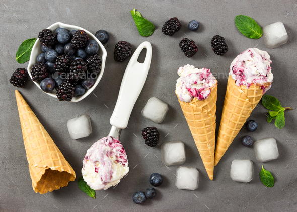 Fruit ice cream with fresh blackberry and blueberry, ice cubes a - Stock Photo - Images