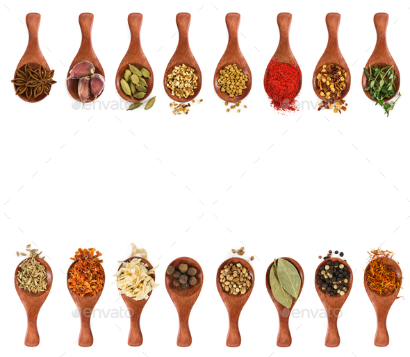 Different seasonings and spices in wooden spoons - Stock Photo - Images