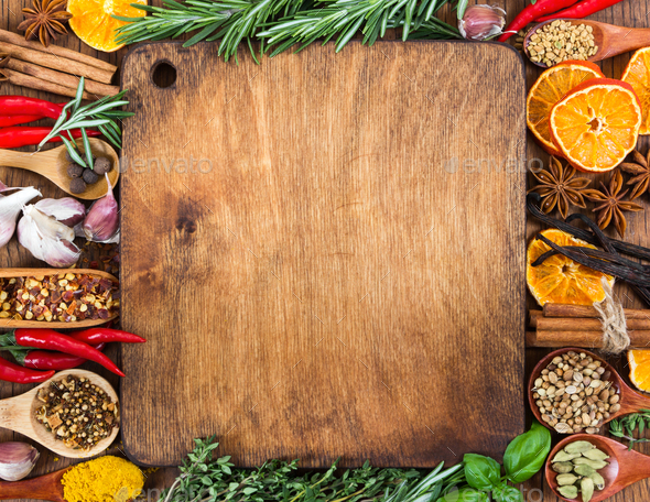 Different spices, seasonings and herbs on wooden background - Stock Photo - Images