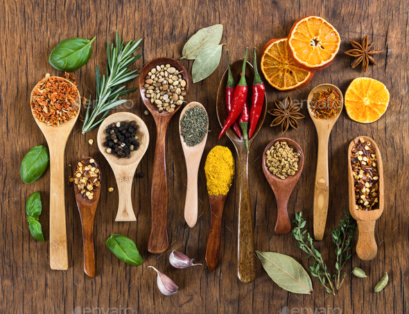 Different spices in wooden spoons - Stock Photo - Images
