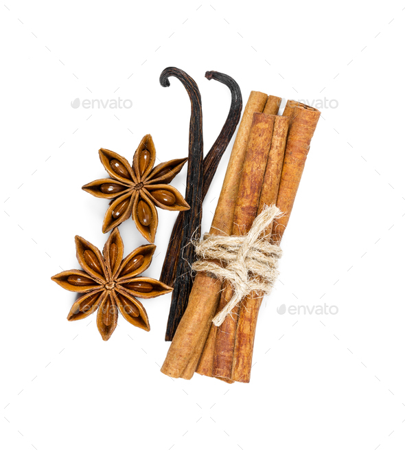 Cinnamon, star anise and vanilla isolated on white - Stock Photo - Images
