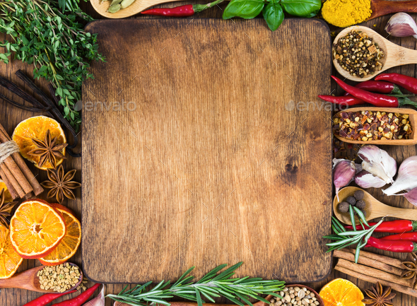 Various spices, seasonings and herbs on wooden background - Stock Photo - Images