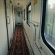 Corridor of a Comfortable Passenger Railway Car. The Train Moves Quickly, the Camera Moves Along the - VideoHive Item for Sale