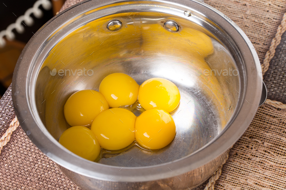 Egg yolks in metal bowl. - Stock Photo - Images