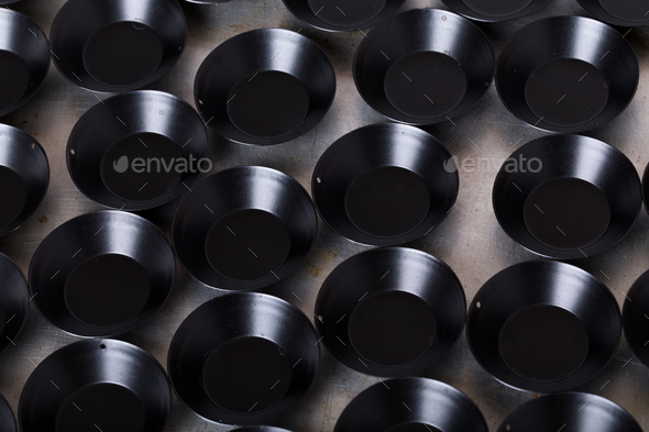 Black metal baking pan for muffins. - Stock Photo - Images