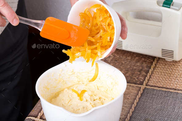 Mixing citrus peels with cake dough. - Stock Photo - Images