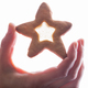 Hand holding star cookie with syrup. - PhotoDune Item for Sale