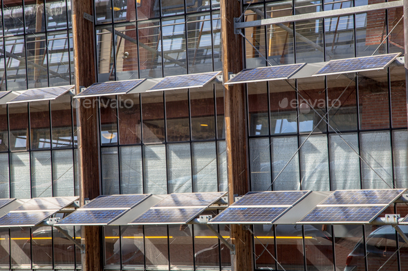 Solar Panels on the Front of an Office Building as a Solution fo - Stock Photo - Images