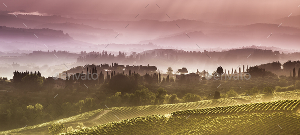 Clouds in the Hills of Tuscany in the early Morning - Stock Photo - Images