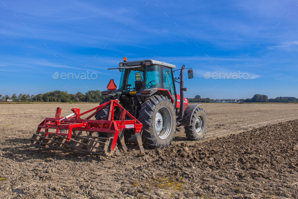 Working Tractor with Plough - Stock Photo - Images