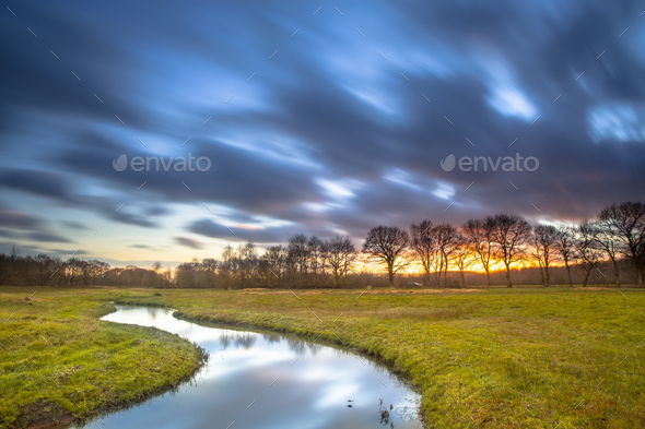 Long Exposue Orange Sunset over River Landscape - Stock Photo - Images