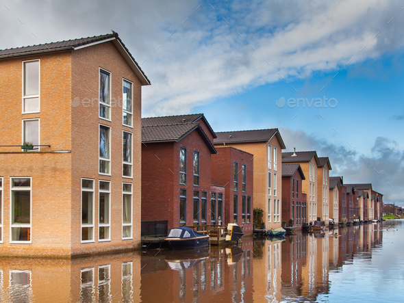 Modern Family Houses along a Canal - Stock Photo - Images