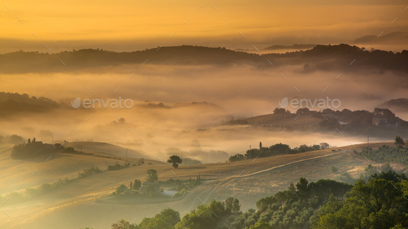 Tuscan Countryside on Foggy Morning - Stock Photo - Images