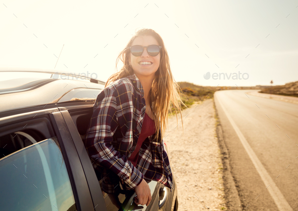 happy girl looking out the car window - Stock Photo - Images